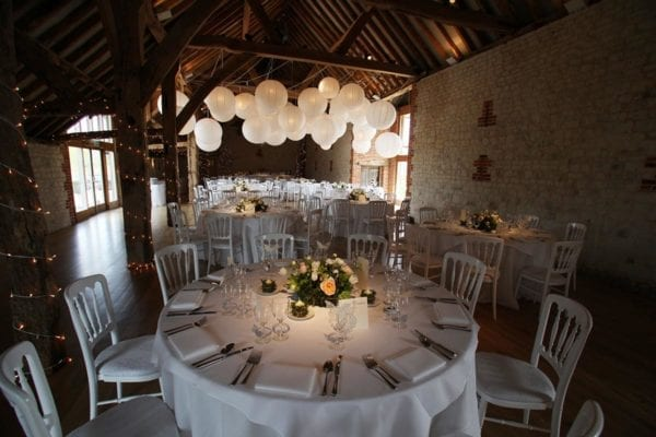 Barn Wedding Lighting at Bury Court Barn Surrey. Tables and lanterns.