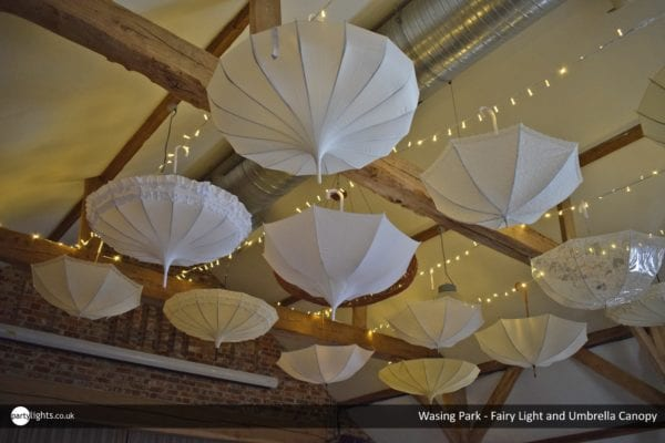 Fairy light and umbrella canopy at Wasing Park