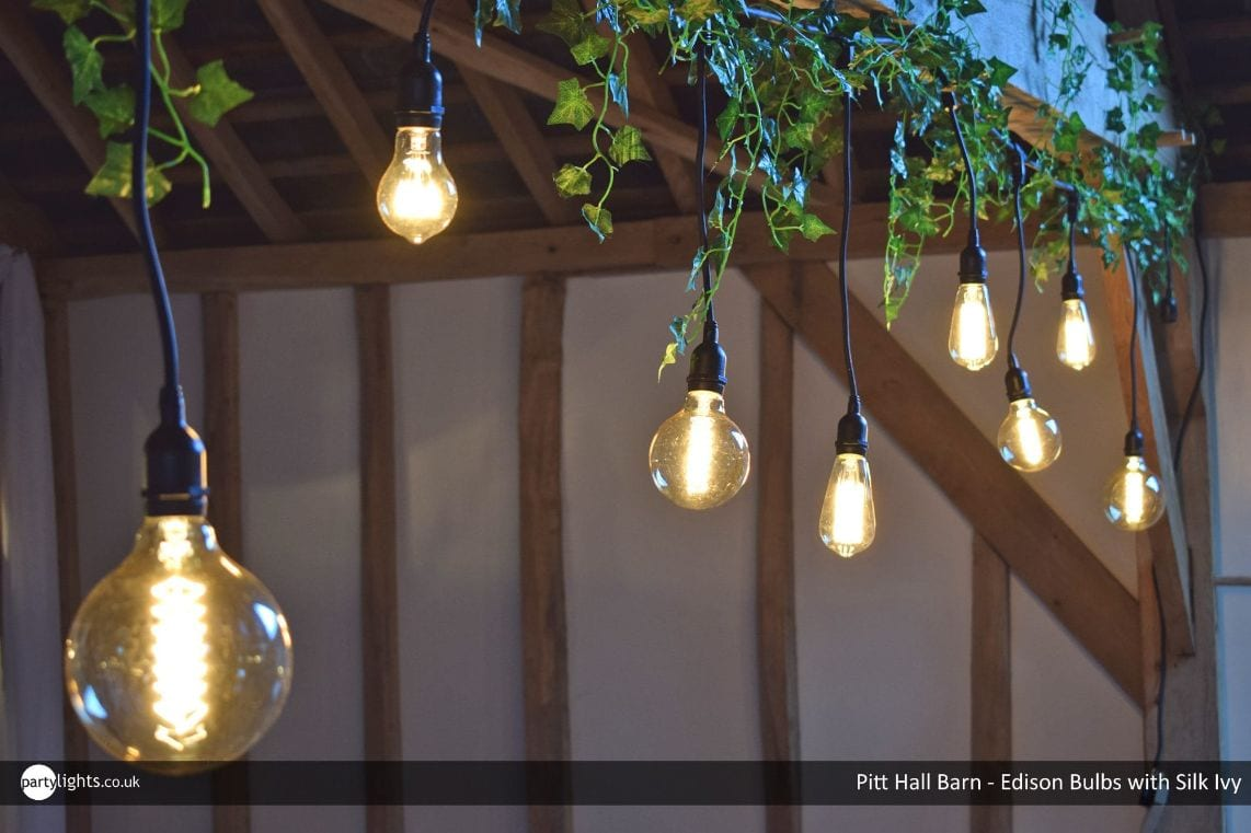 Light bulbs hanging from roof beams
