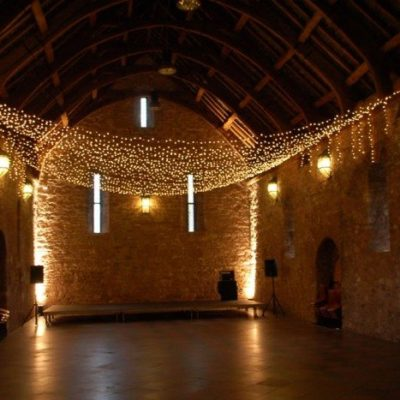 Farnham Castle with fairy light canopy and fairy light curtains