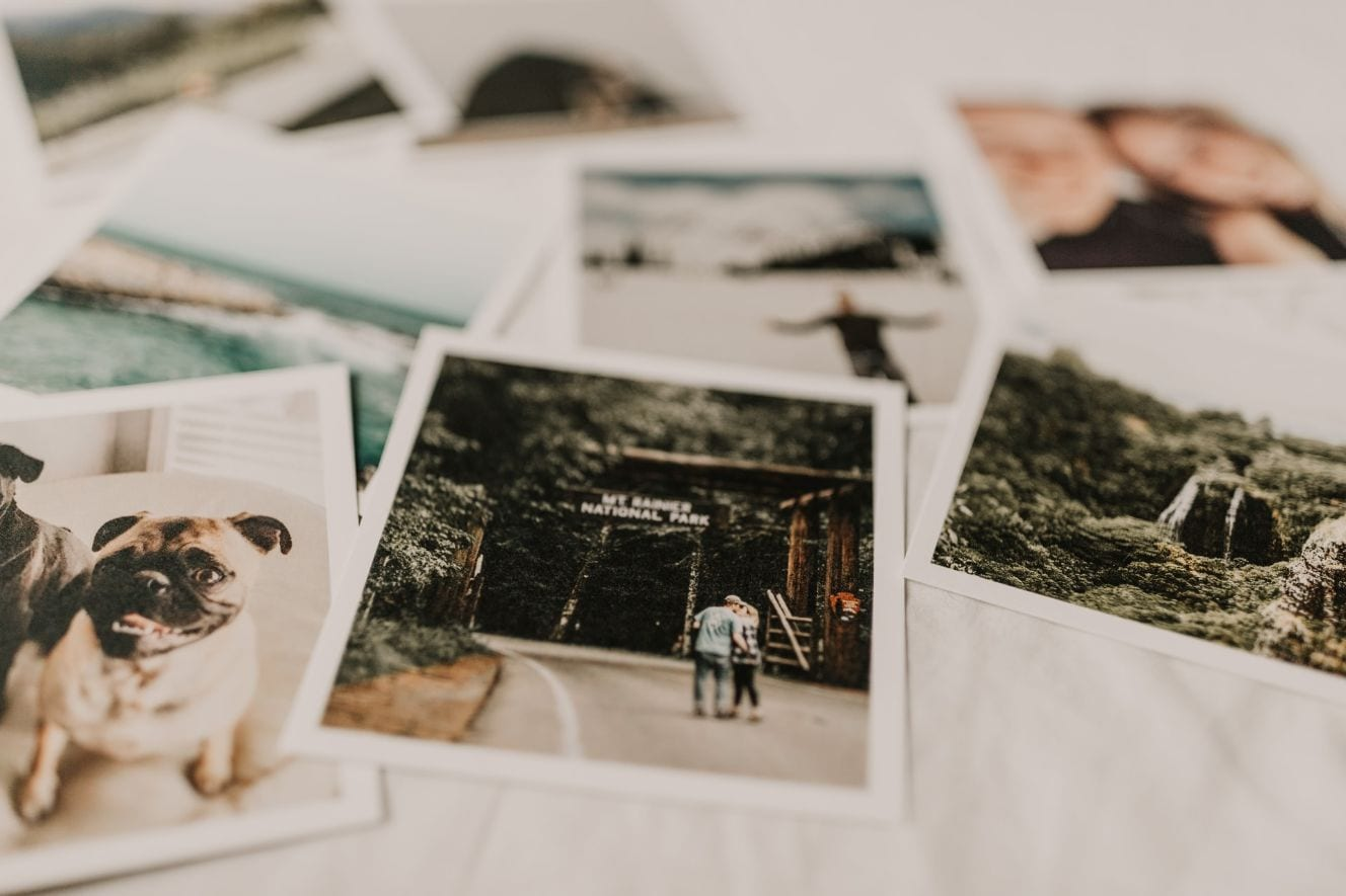 close up of Polaroid pictures laid on a bed