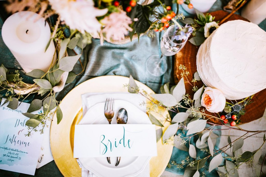 Table with various wedding decorations on it