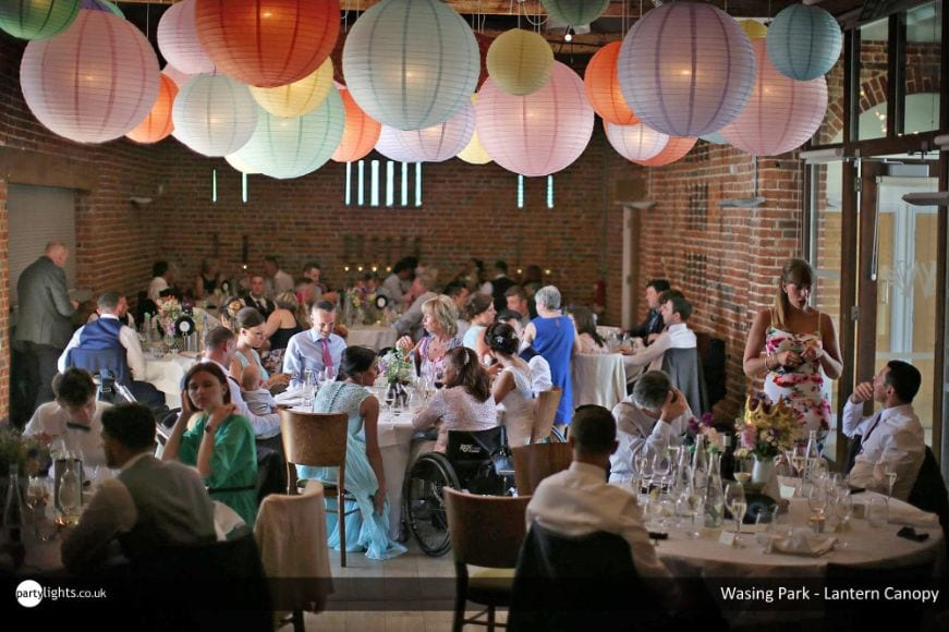 Wedding venue decorated with pastel hanging lantern canopy